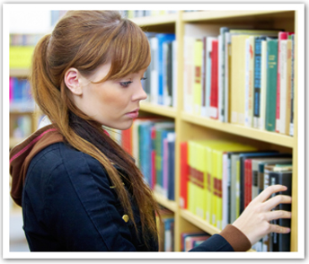 Girl choosing books from shelves