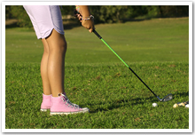 Closeup of a young girl playing golf.