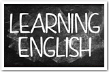 "The words ""Learning English"" written on a chalkboard."