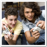Two teen guys gaming