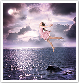 A young girl dressed as a fairy and flying over water.