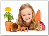 A young girl with gardening tools and flower pots.