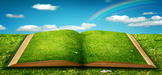 An open book, under a rainbow, that has grass on the pages.