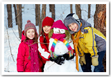 Happy children with a snowman.