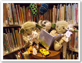 A collection of stuffed characters reading books and playing with toys