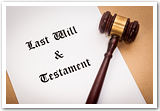 "A paper that reads ""Last Will & Testament"" and a gavel."