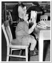 Sudbury Public Library, March 8, 1947. Gail Dingle reading